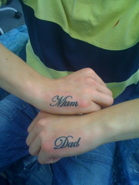 Mum and dad tattooed on hands